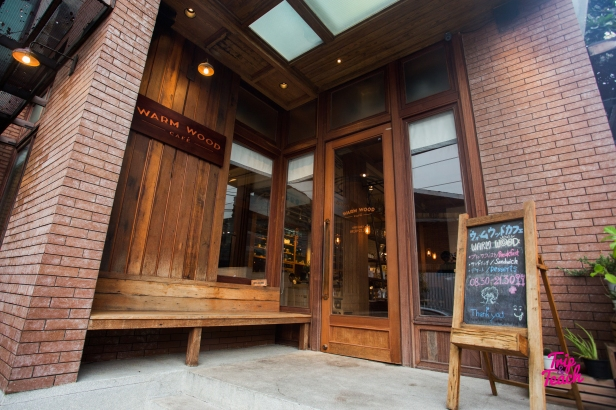 The wooden front door and large windows panes are located right at the corner of Thonglor Soi 10