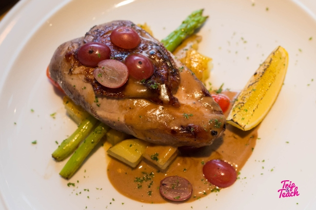 Grape chicken, grape chicken sauteed potato, grape, asparagus, lemon, taragon sauce, 320 Baht