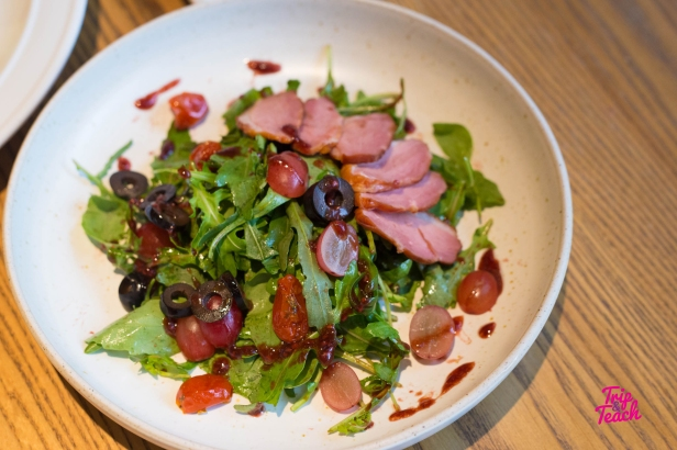 Smoked Duck Salad, smoked duck, rocket leaves, sun dried tomato, grape, respberry dressing 240 Baht